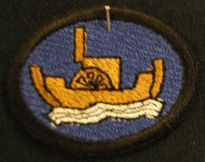 10591 Koulutusmerkki, merilotta, repro